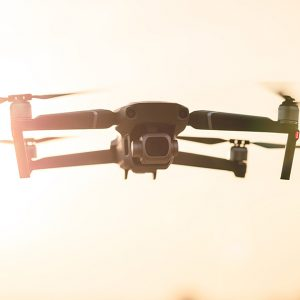 What are the benefits of using drones for filming real estate and commercial buildings